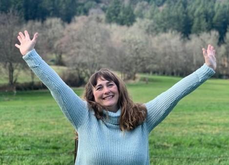 Gwen Hinkle jumping for joy