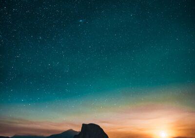 sunrise starting to light the night sky with stars