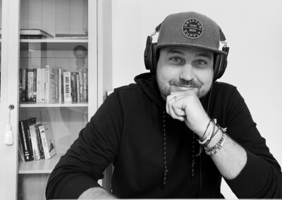 Black and white of a man with headphones on