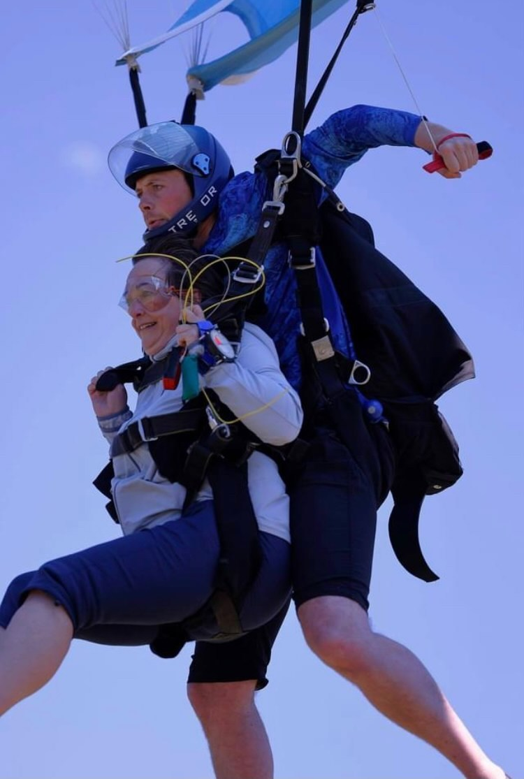 guy and gal skydive tandem